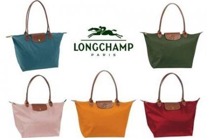 Â¡Luce a la moda en Navidad! Paga RD$2,900 en vez de RD$6,350 por Cartera Longchamp le pliage Mediana en Brand Accesories.